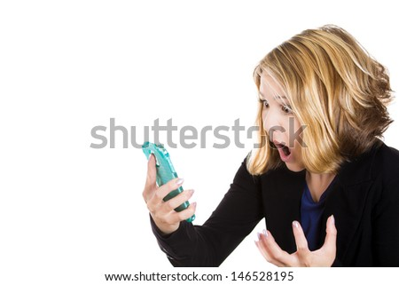 SMS. Funny young businesswoman reading bad news text message. Beautiful young  caucasian woman isolated on white background holding her smart phone - stock photo
