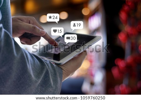 sms media man use  smart phone social media network pop notification icons #1059760250