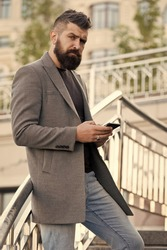 SMS messaging business. Bearded man texting sms outdoor. Businessman send sms using smartphone. Sms message. Short message service. Text messaging by mobile phone. Mobile marketing.