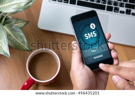 SMS Messaging Communication Notification Alert Reminder  sms Thoughtful male person looking to the digital phone screen,Silhouette top computer and hand