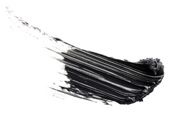 Smudged black mascara isolated on white background. Cosmetic product swatch. Paint brush stroke