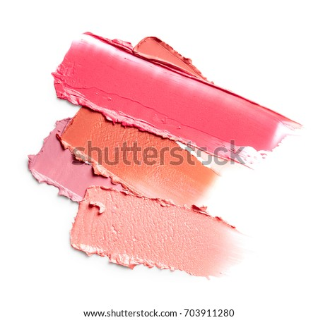 Smudged lipsticks isolated on white background #703911280