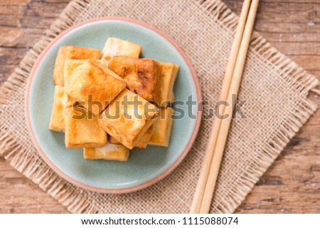 Snack and Dessert, Chinese Traditional Deep Fried Tofu or Fried Bean Curd  on wood background