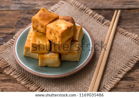 Snack and Dessert, Chinese Traditional Deep Fried Tofu or Fried Bean Curd  on wood background #1169035486