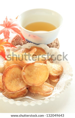 snack food, sweet potato chip on dish with green tea for japanese tea time image