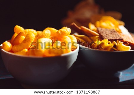 Snack mix. Salty treat for snacking. Dark background