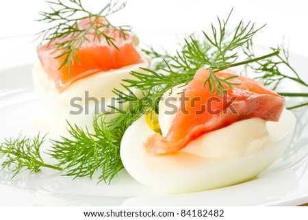 snack of salted eggs and trout on a plate