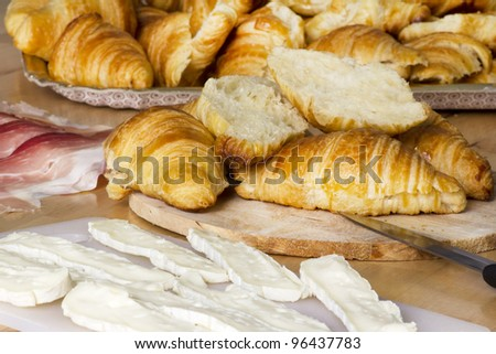 snack preparation with croissants, cheese and Parma ham