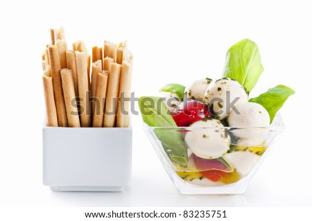 snack with grissini and tomato mozzarella - stock photo