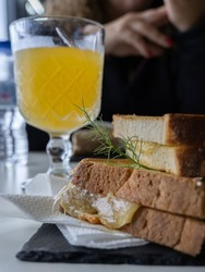 Snack with local products, island cheese sandwich with passion fruit juice. Santa Cruz das Flores, Flores Island.