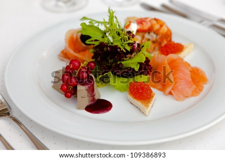 Snacks on a plate of eggs, fish, duck pate