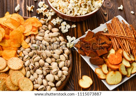 Snacks on a wooden background. Space for text or design.
