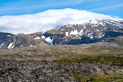 Snaefellsjokull, Iceland snowcapped glacier mountain peak in national park closeup view of volcanic scenery and blue sky