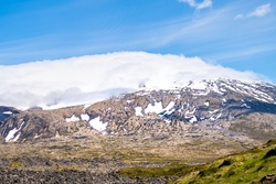 Snaefellsjokull, Iceland snowcapped glacier mountain top peak in national park closeup view of volcanic scenery and blue sky