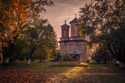 Snagov Monastery in a beautiful autumn landscape at sunset