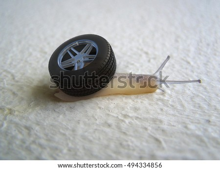 snail with a wheel of car instead of its shell, 3d illustration