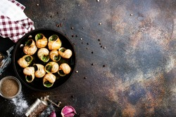 Snails baked with sauce, Baked snails with butter and spice