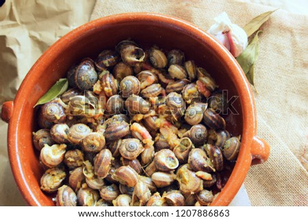 Snails made in a sauce with bacon