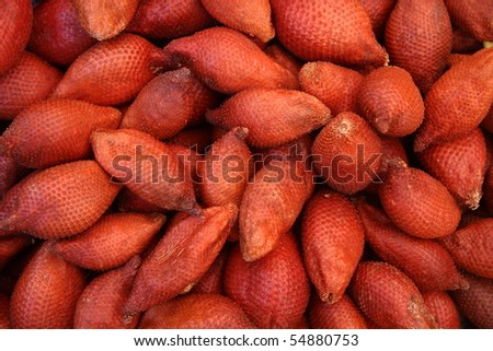 snake fruit on a market stand - stock photo