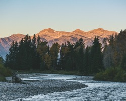 Snake River in Jackson, Wyoming with mountains in the background.