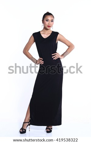Stock Photo Snap Full length Asian Thai Female Model with Tan Skin on in Black long dress with Studio Lighting on White Background, and shadow on wall silver