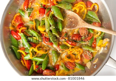 Snap Peas, Tomatoes, Orange Bell Peppers Sauteed in Coconut Milk with Herbs and Spices