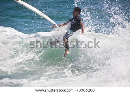 gold coast australia surfing. GOLD COAST, AUSTRALIA - 25