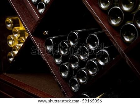 Snapshot of the wine cellar. The bottles on wooden shelves. #59165056