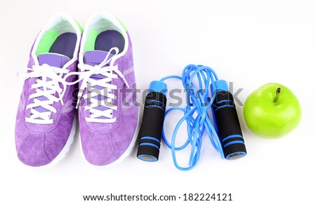 Sneakers and sport equipment. Conceptual photo of fitness progress. Isolated on white #182224121