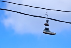 Sneakers Caught on a Telephone Wire