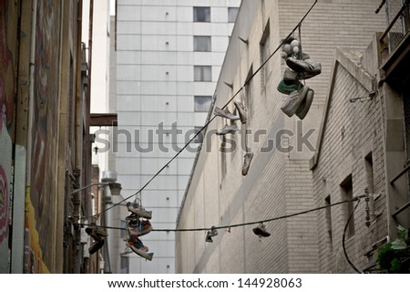 Sneakers hanging by the laces over powerlines