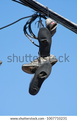 Sneakers hanging from wire #1007710231