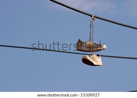 Sneakers hanging on a phone wire by a Los Angeles street gang to mark heroin drug sale area