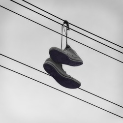 Sneakers Hanging On A Telephone Wire