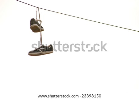 Sneakers hanging on wire