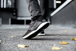 sneakers in motion, sneakers on asphalt