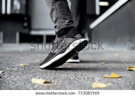 sneakers in motion, sneakers on asphalt