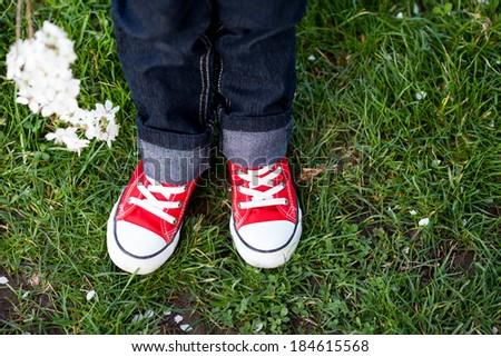Sneakers on a kids feet  #184615568