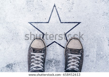 Sneakers on the road with star shape imprint - talent, vip, prize and award concept
