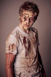 Sneering Teenager Zombie in torn bloody shirt