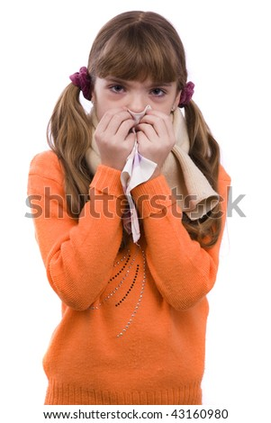 Sneezing. Little girl on white background in winter clothing is sick ...