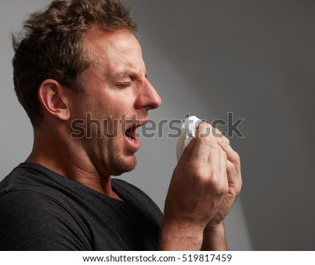 sneezing man with cold