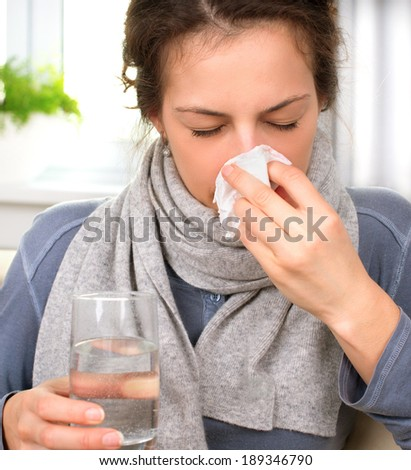 Sneezing woman into tissue. Sick Woman. Flu. Woman Caught Cold. Allergy. Headache. Virus. Medicines