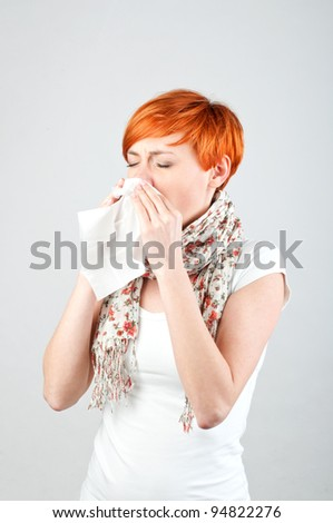 Sneezing woman with a handkerchief