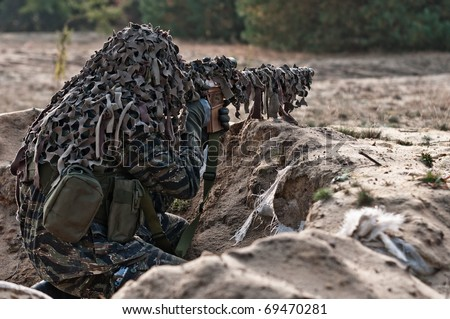Sniper with rifle hidden in trench, stealth warrior, precise shoot