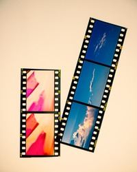 Snippet of the developed slide film on a light table in studio. For design.