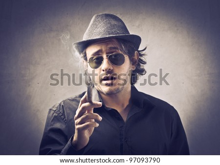 Snobbish boss smoking a cigar