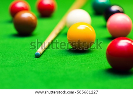 snooker balls and cue on the table #585681227