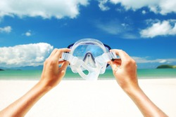 Snorkel equipment against beach and sky
