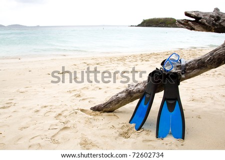Snorkel gear on a sandy beach.